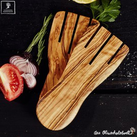 modern salald hands out of olive wood